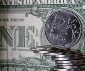 Курс рубля укрепился пользуясь благоприятными внешними